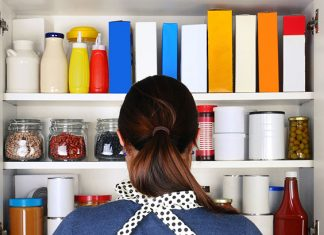 woman standing in front of kitchen cabinet