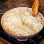 sliced onions in a skillet