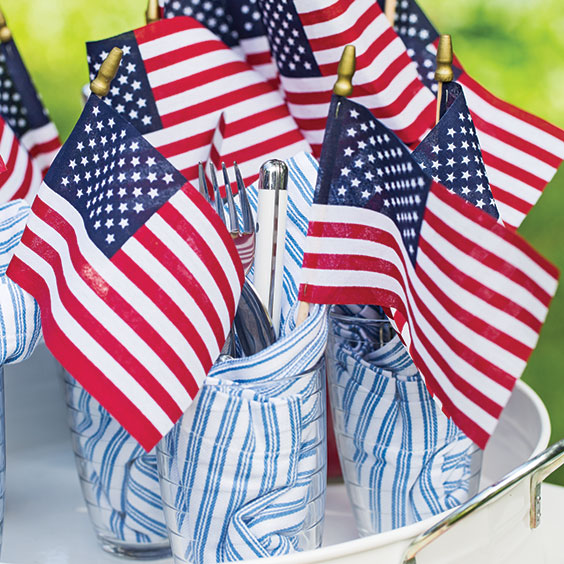 small united states flags on a table