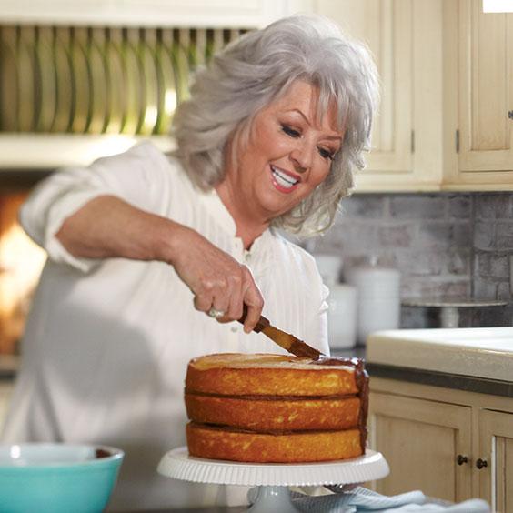Paula Deen frosting a cake
