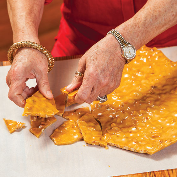 breaking peanut brittle