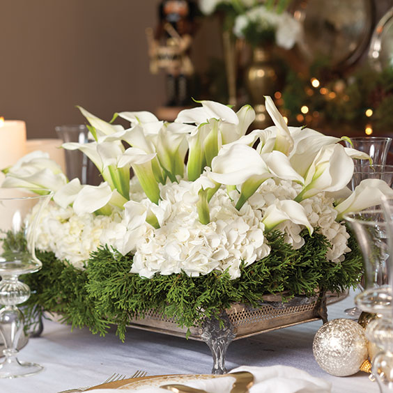 Poinsettia & Magnolia Silk Holiday Silk Centerpiece at Petals