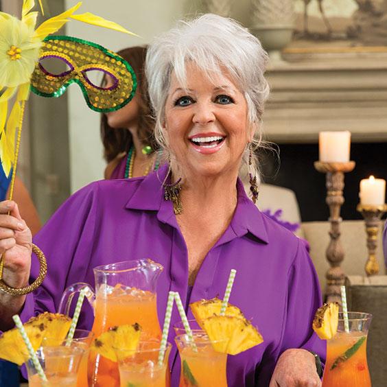 Paula Deen holding Mardi Gras masks