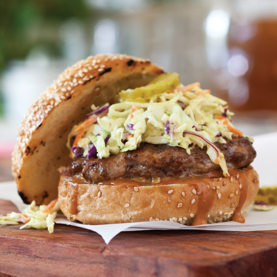 burger with barbecue sauce and coleslaw