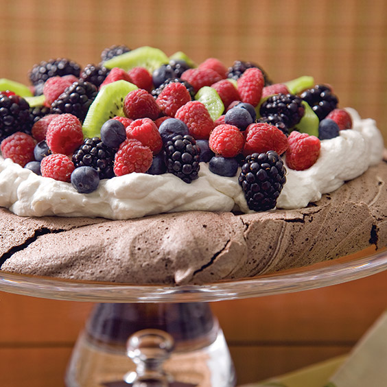 pavlova dessert with berries and whipped cream