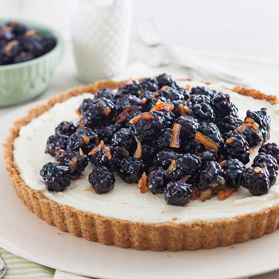 orange mousse tart with blackberries