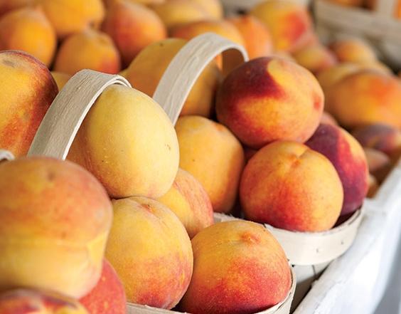 baskets of fresh summer peaches