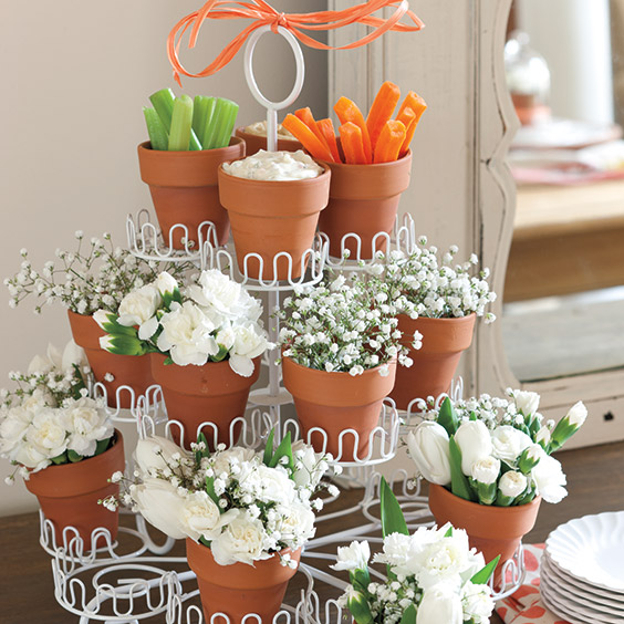 mini terra-cotta pots in a cupcake holder